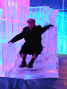 Norman Veit playing on the ice slide