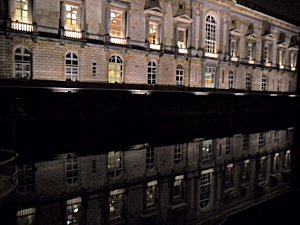 Palais de Justice reflected in River Lei