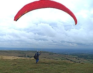 Para gliding from the summit.